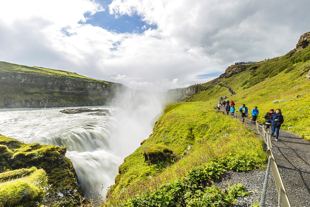Tourists visiting Gullfoss (Golden Falls), a waterfall located in the canyon of the Hvita River in southwest Iceland, Polar Regions