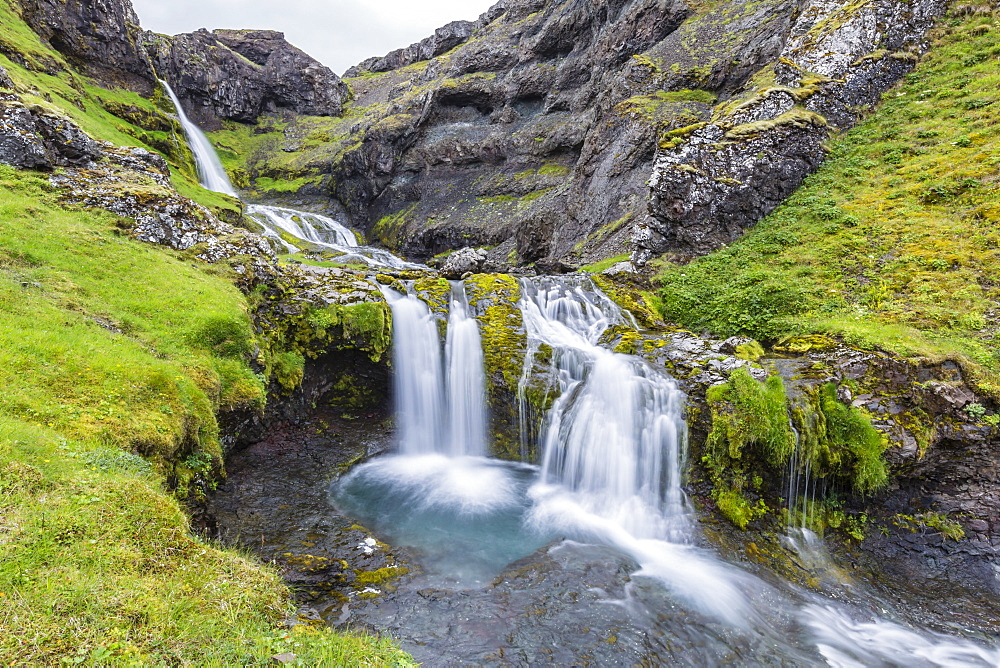 Small waterfall just outside the town of Grundarfjordur on the Snaefellsnes Peninsula, Iceland, Polar Regions