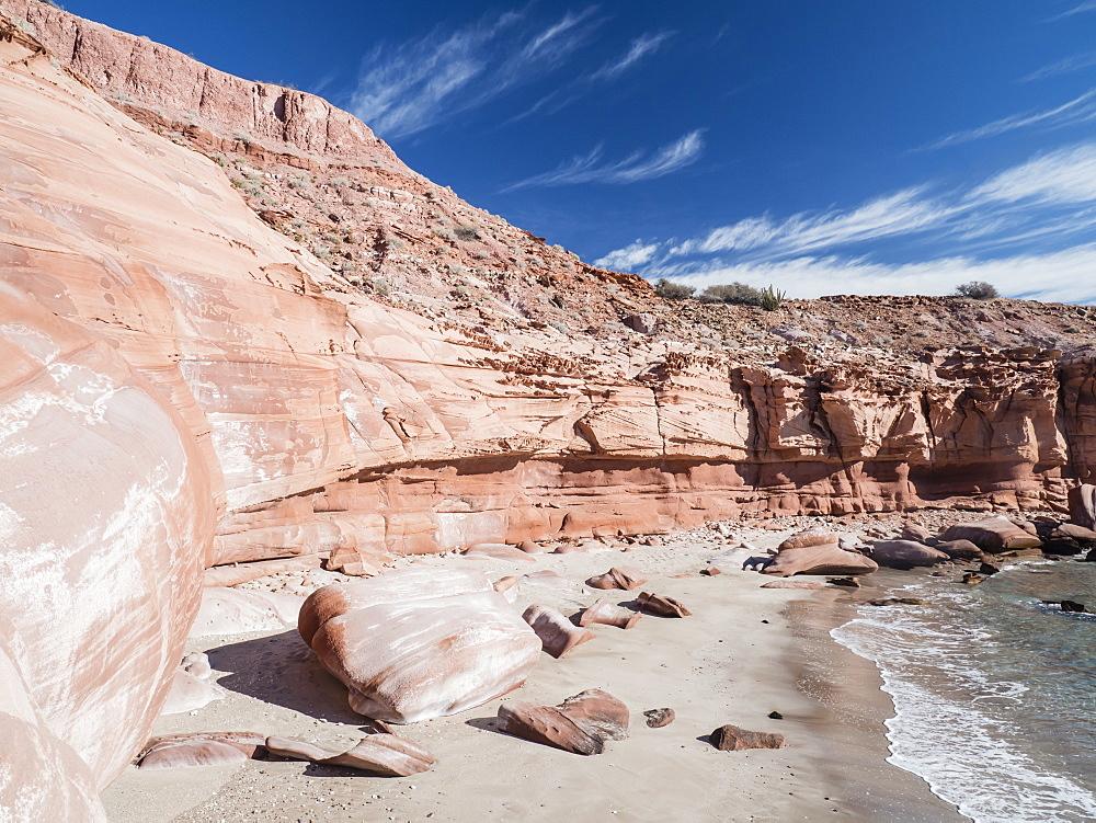 Red sandstone cliffs at Puerto Gato, Baja California Sur, Mexico, North America