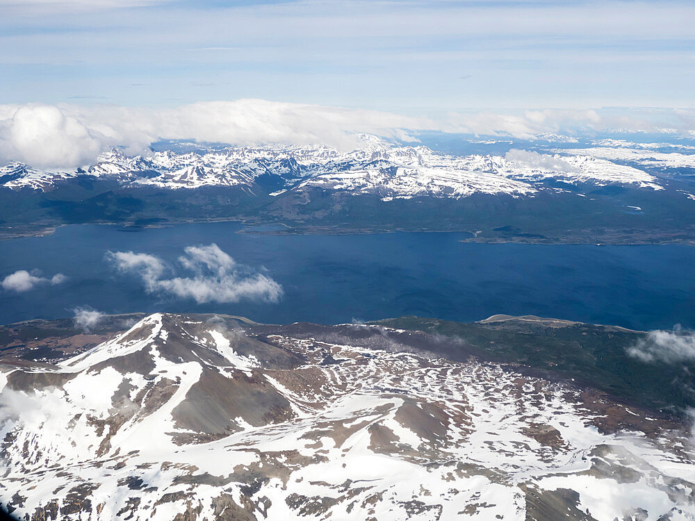 An aerial view of the snow-capped Andes Mountains surrounding the Beagle Channel, Argentina, South America