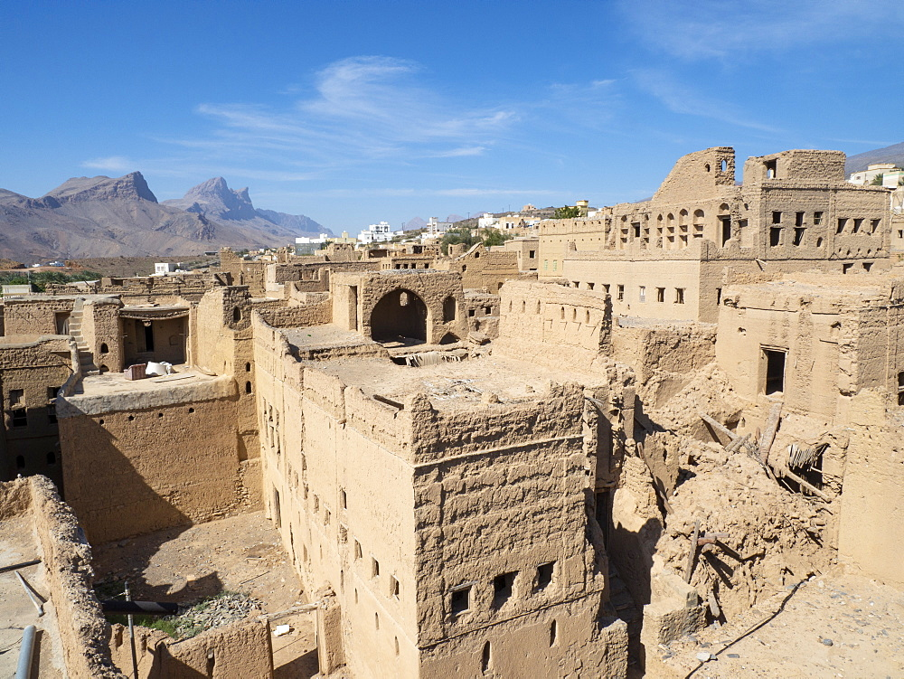 Exterior view of a mostly abandoned mud construction houses in Bait Al Safah, Al Hamra, Sultanate of Oman, Middle East