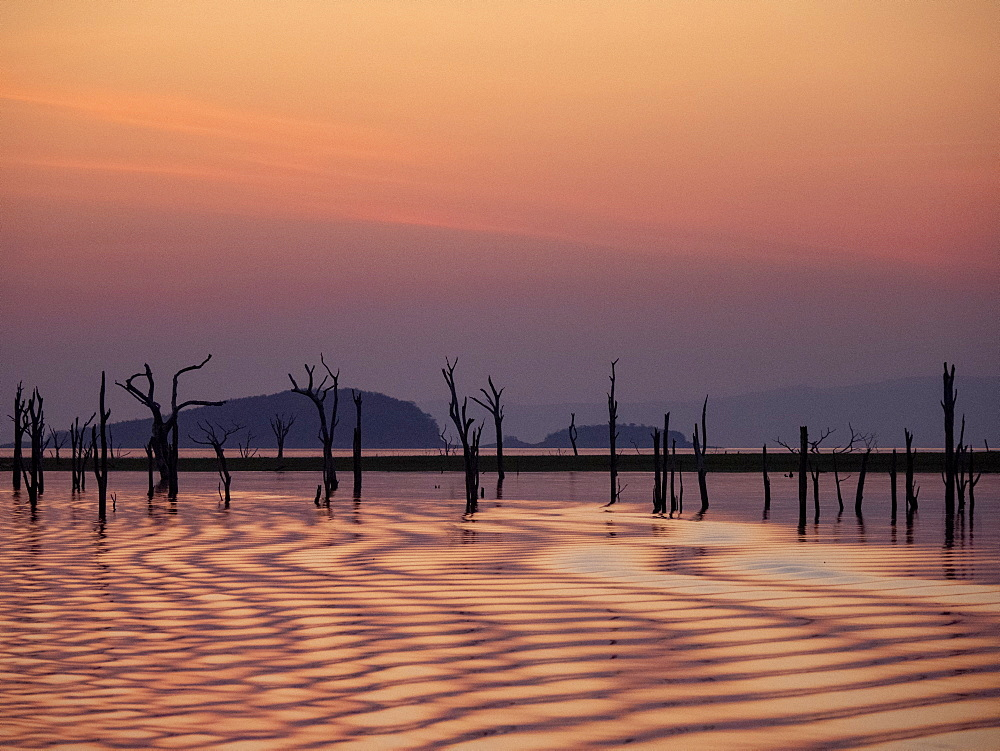 Sunset over Lake Kariba, the world's largest man-made lake and reservoir by volume, Zimbabwe.