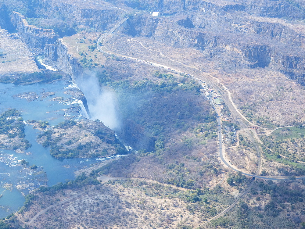 Aerial view of Victoria Falls on the Zambezi River, straddling the border of Zambia and Zimbabwe,