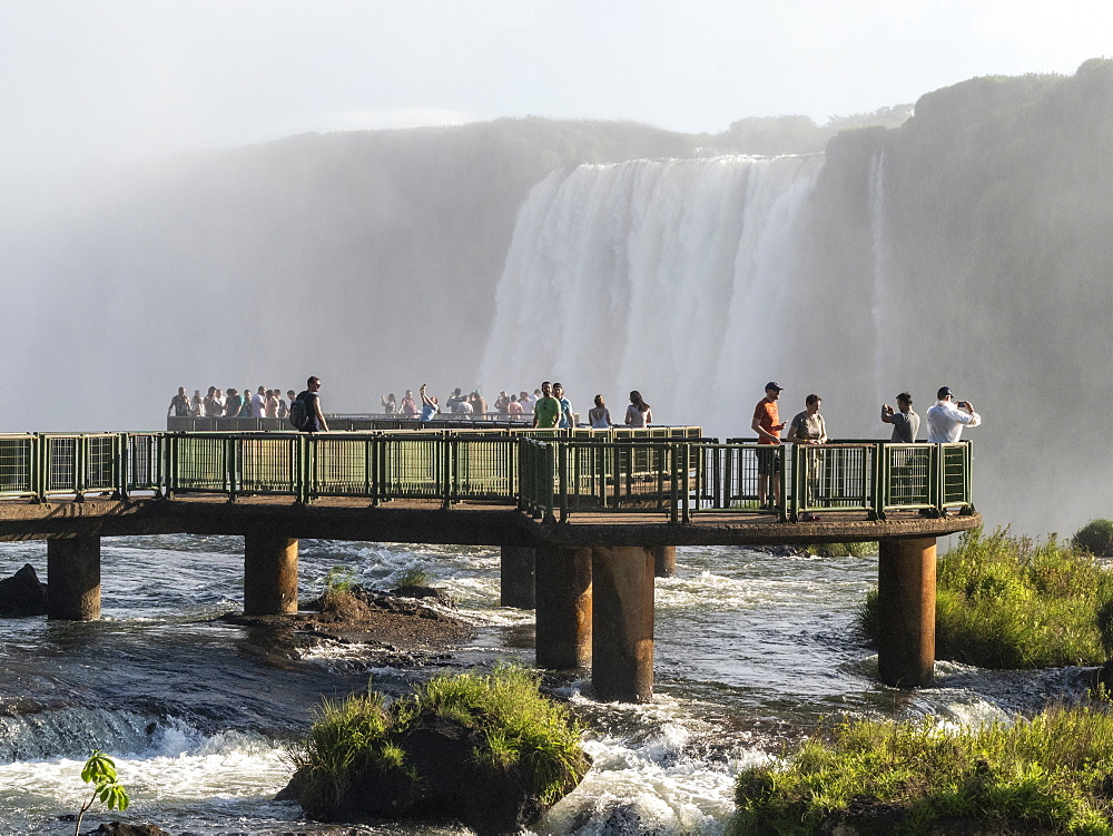 Tourists on viewing platform at Iguazv? Falls, Cataratas do Iguav?u, from the Brazilian side, Paranv?, Brazil.