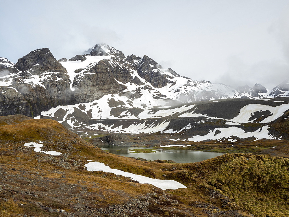 Snow-covered mountains and glacial meltwater lake in Gold Harbor, South Georgia, Polar Regions - 1112-5210
