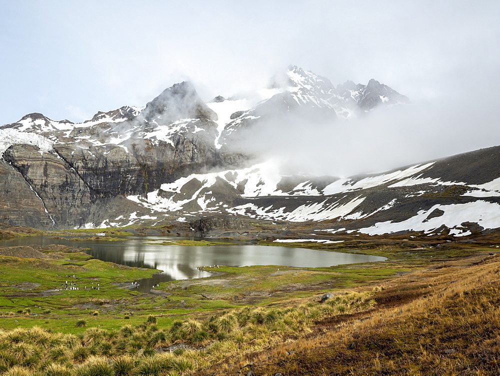 Snow-covered mountains and glacial meltwater lake in Gold Harbor, South Georgia, Polar Regions - 1112-5211