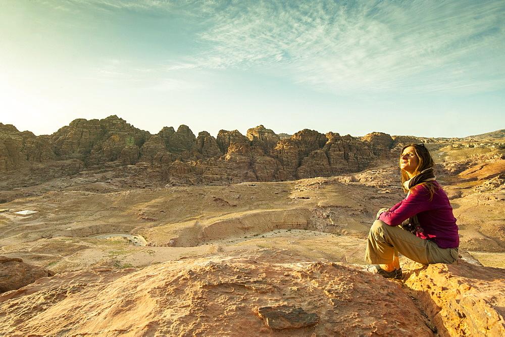 Woman sitting on a stone, Petra, Wadi Musa, Jordan, Middle East - 1113-104421