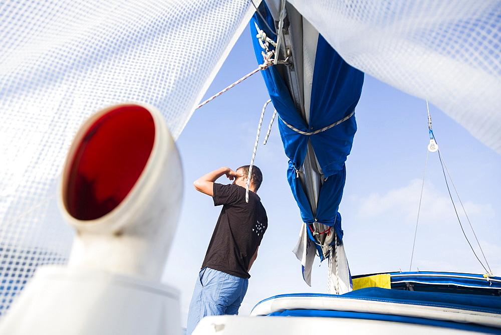 Man on a sailing boat looking at view, Istria, Croatia - 1113-104453
