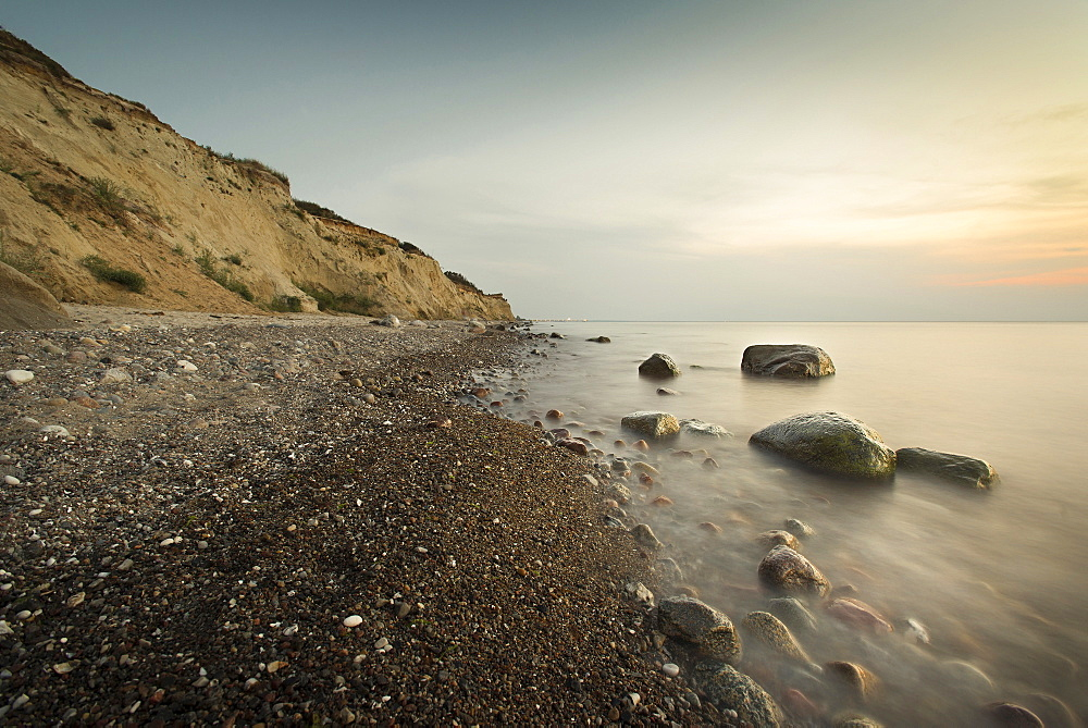 Large stones on a pebble beach at the Baltic Sea in the evening mood, Wustrow, Darss, Mecklenburg Vorpommern, Germany - 1113-104770