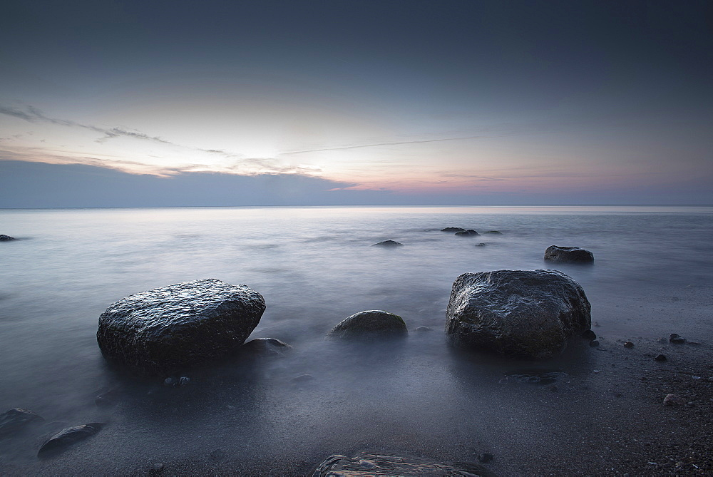 Large stones on a pebble beach at the Baltic Sea in the evening mood, Wustrow, Darss, Mecklenburg Vorpommern, Germany - 1113-104771