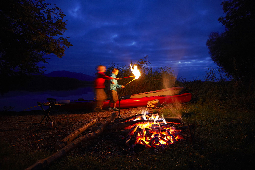 Children at bonfire, lake Staffelsee, Seehausen, Bavaria, Germany - 1113-104860