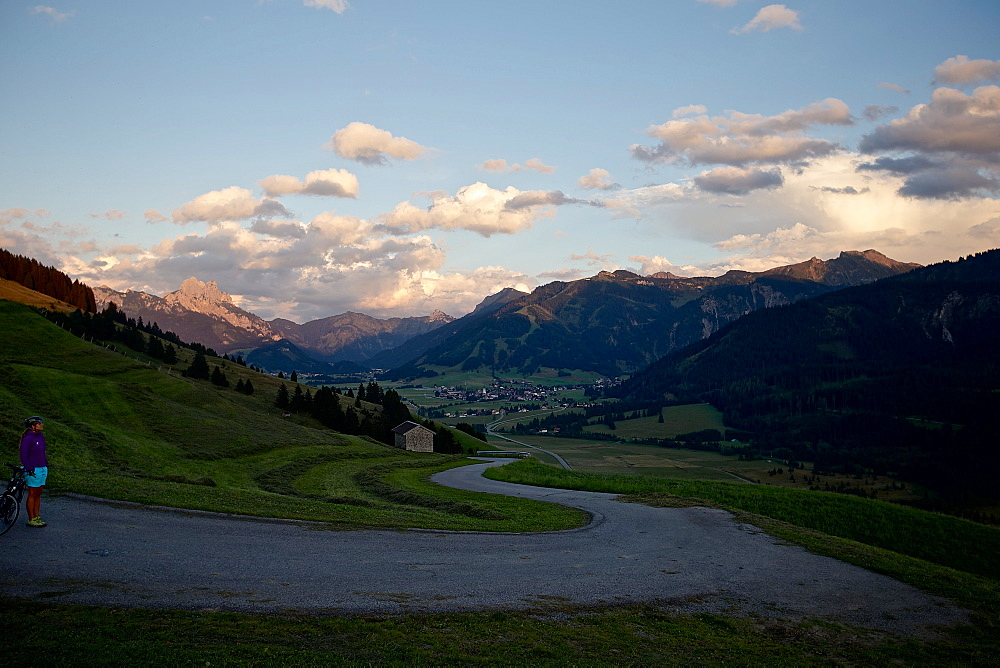Young female cyclist having a break to enjoy the ambiance, Tannheimer Tal, Tyrol, Austria - 1113-104947