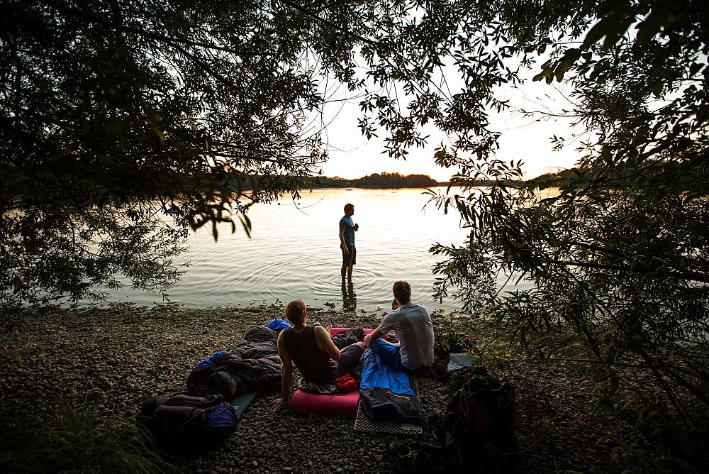 Three young men camping at a lake, Freilassing, Bavaria, Germany - 1113-105161