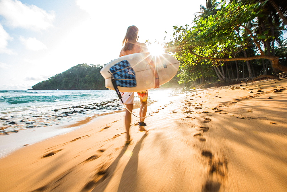 Young female surfer walking along the beach, Sao Tome, Sao Tome and Principe, Africa - 1113-105192