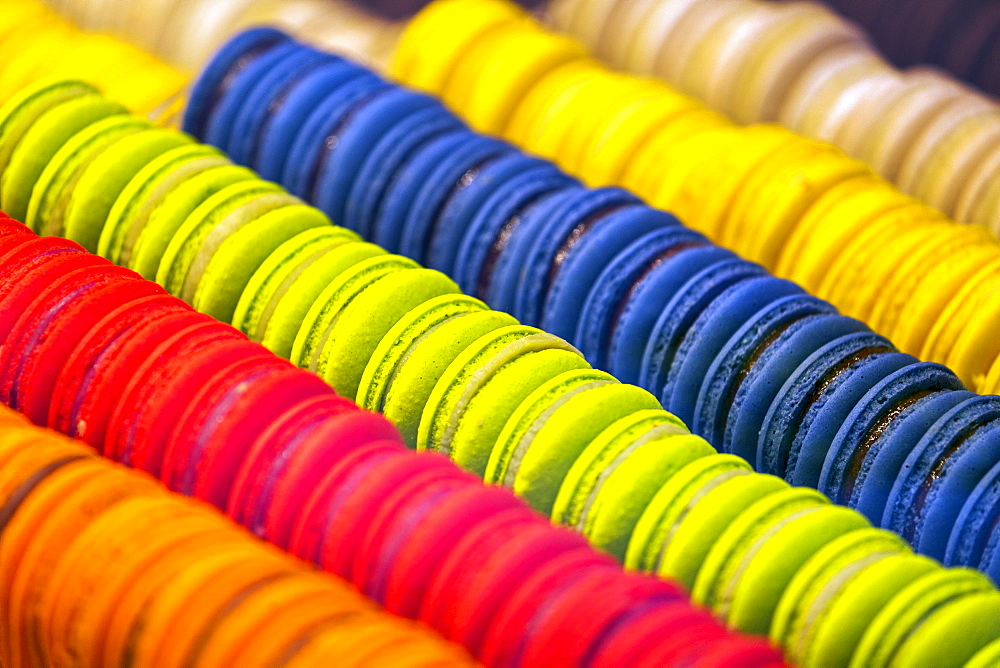 Close-up of colourful macaroons all in a row in store showcase, Luxembourg City, Luxembourg