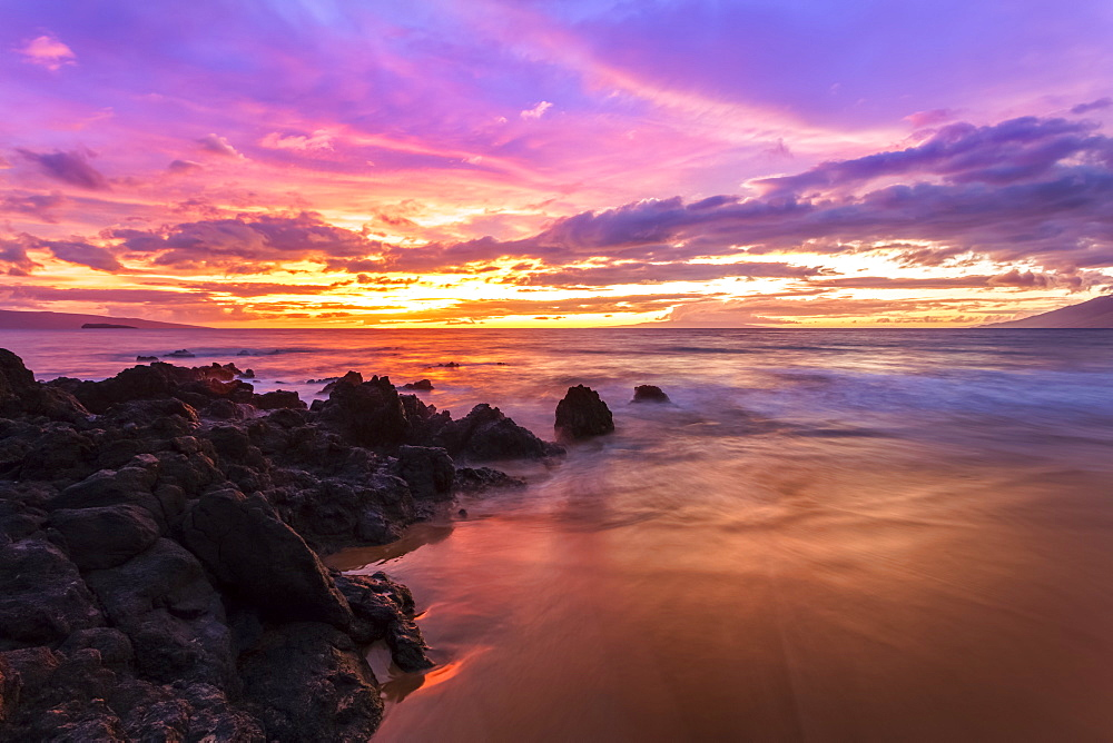 Dramatic beach sunset with soft water, Makena, Maui, Hawaii, United States of America
