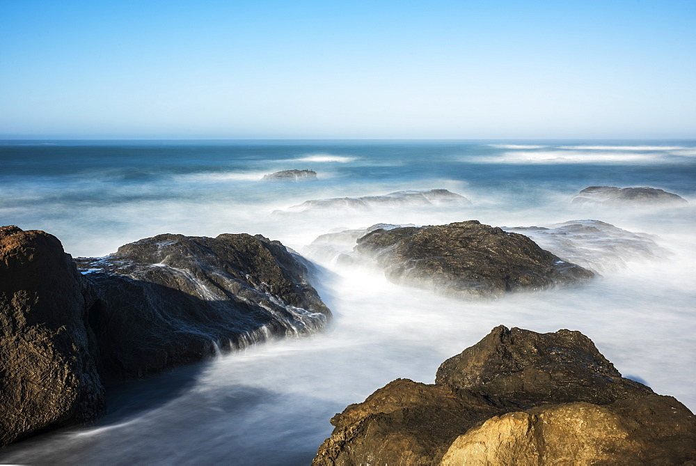 Waves softened by a long exposure surge onto the beach at MacKerricher State Park and Marine Conservation Area near Cleone in Northern California, Cleone, California, United States of America