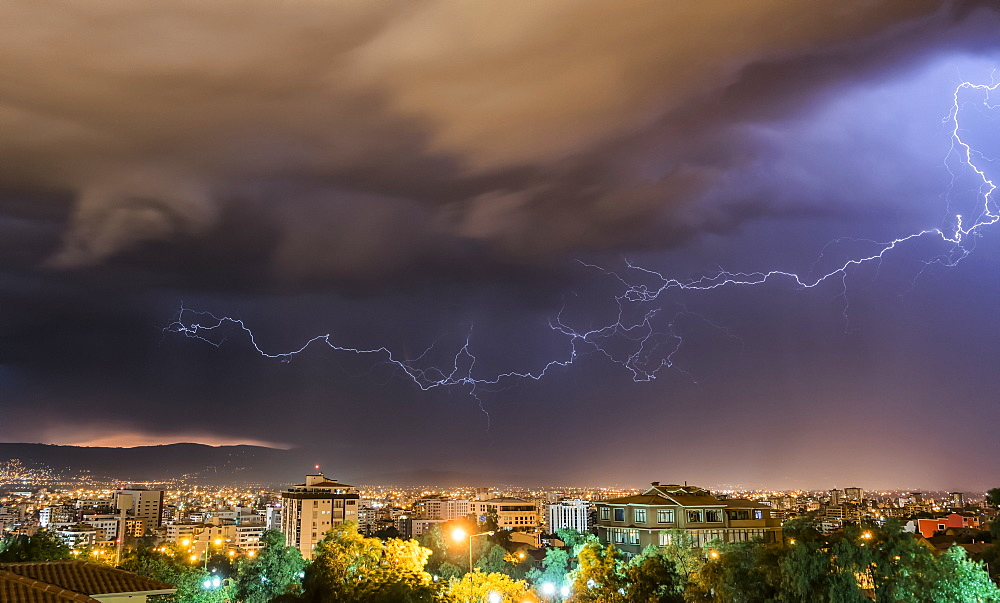 Stormy skies and lightning over a city at night, Cochabamba, Bolivia - 1116-47329
