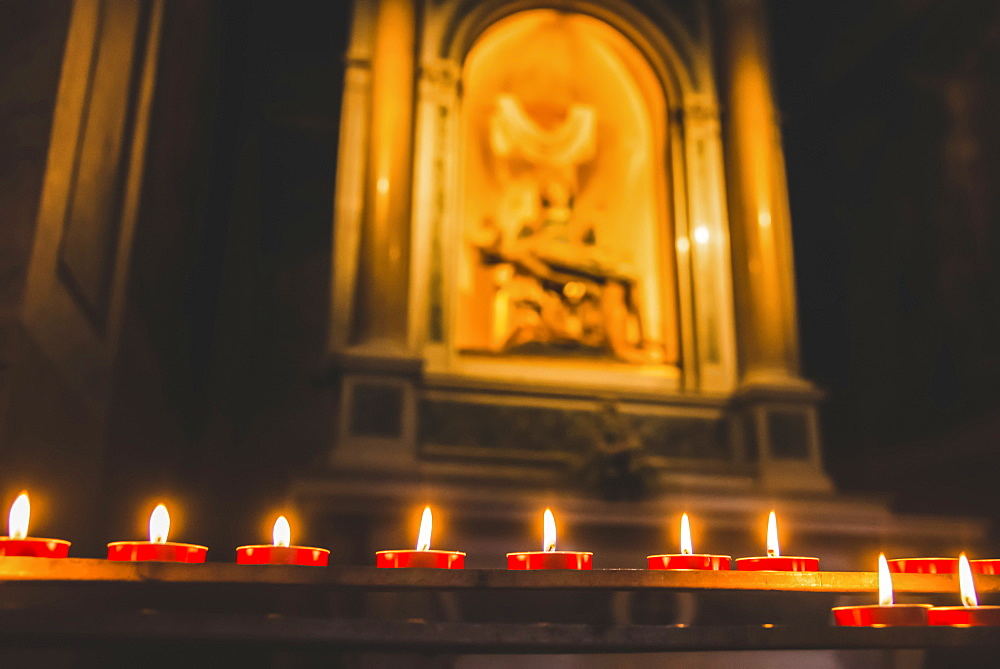 Candlelight in a basilica, Trieste, Friuli Venezia Giulia, Italy