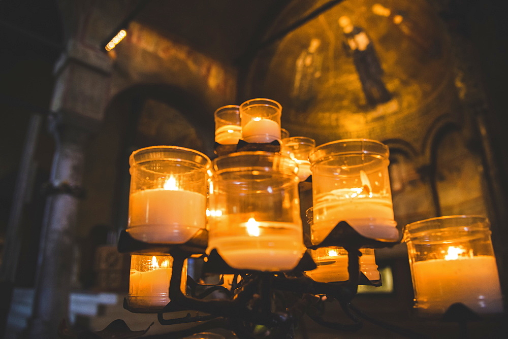 Lit candles and artwork in a cathedral, Italy - 1116-47469