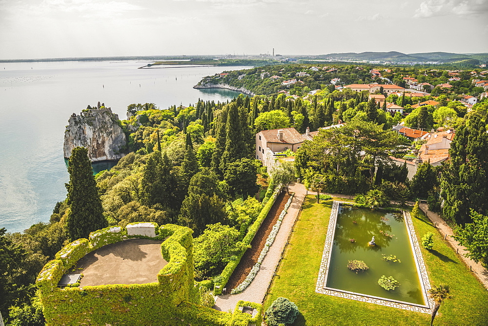 Landscaped grounds of Duino Castle and a view of the coastline of the Gulf of Trieste, Italy