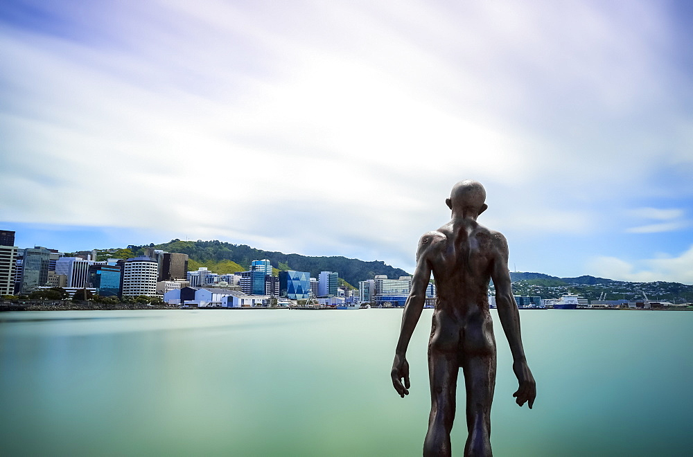 Statue of a clothesless man in the port of Wellington City, Wellington, North Island, New Zealand