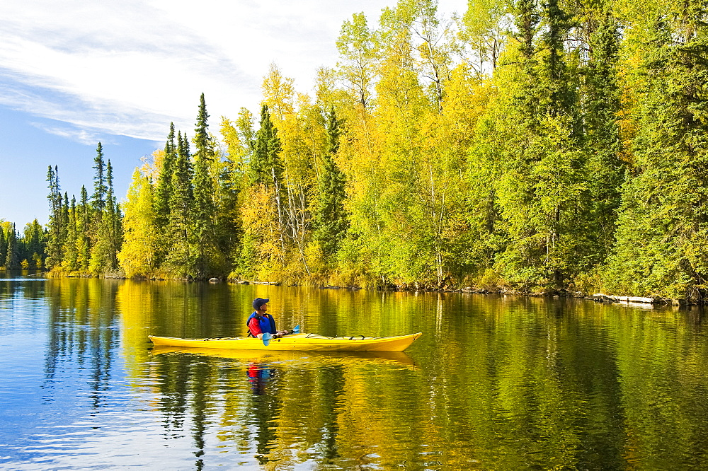 A man kayaking at MacKay Lake, Northern Saskatchewan, Saskatchewan, Canada