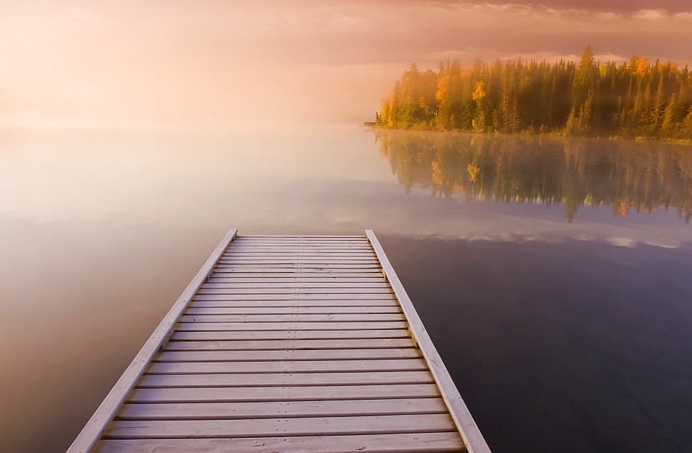 Frost covered dock at sunrise, Glad Lake, Duck Mountain Provincial Park, Manitoba, Canada