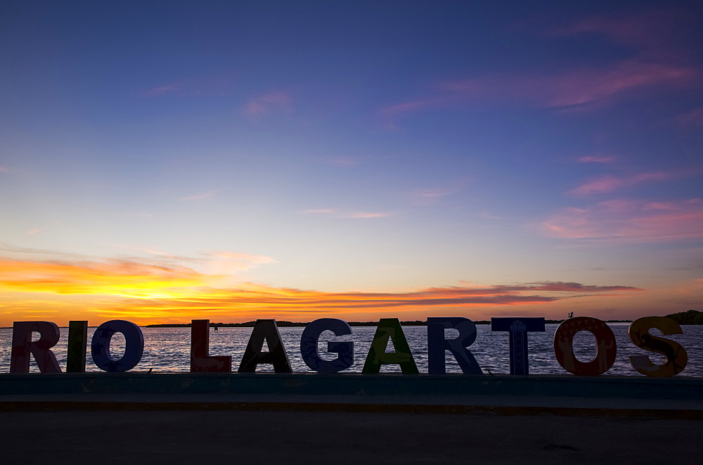 City sign at sunset, Rio Lagartos, Yucatan, Mexico