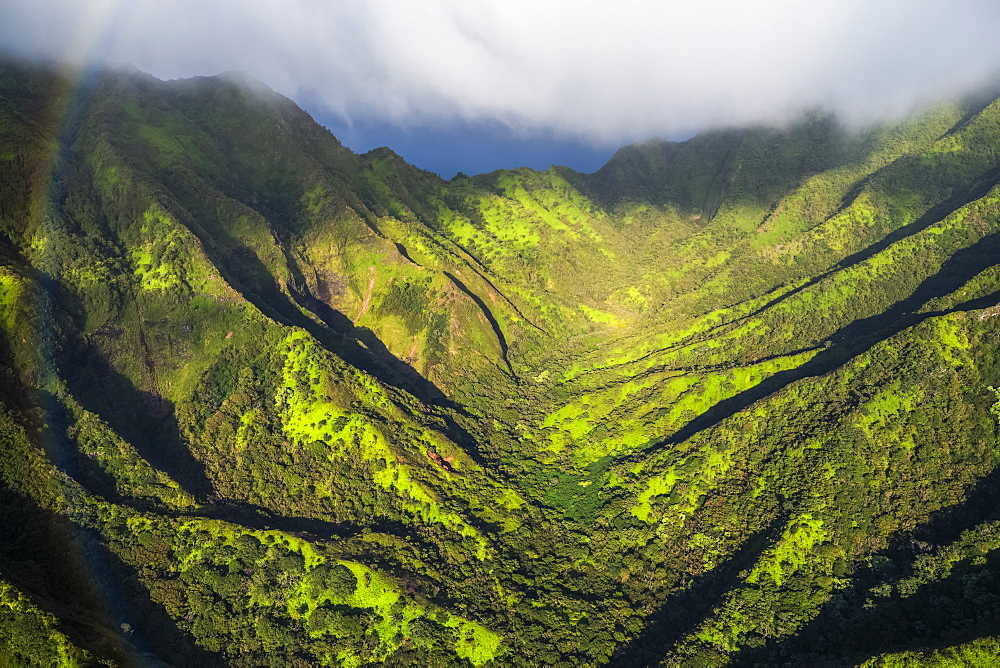 Aerial image of the lush mountains surrounding Oahu with a rainbow in the foreground, Oahu, Hawaii, United States of America
