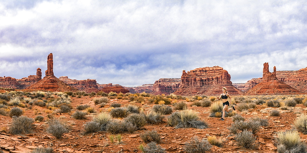 Jogger in the Valley of Gods with rock formations, panorama of stitched images, Utah, United States of America