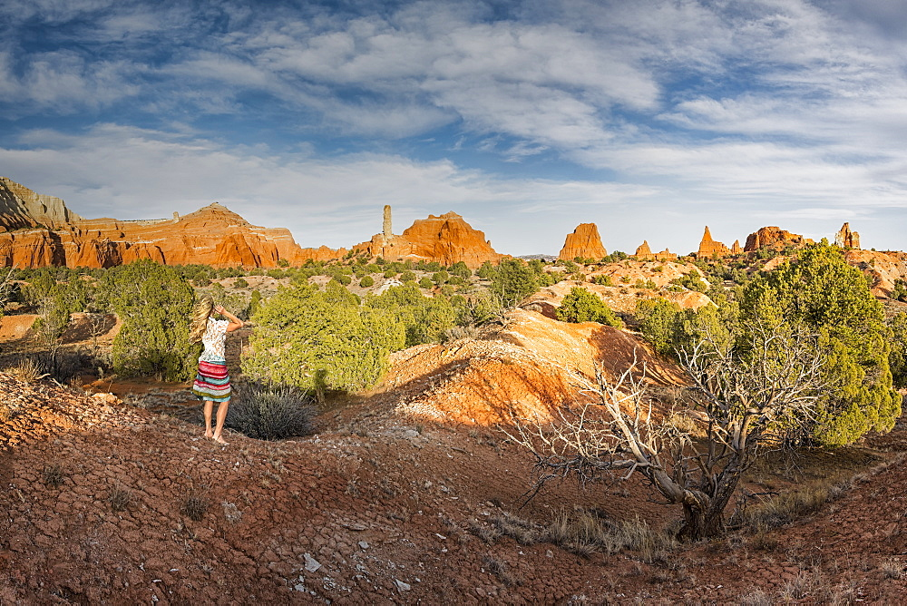 Woman stands barefoot along the Panorama Trail in Kodachrome State Park, Cannonville, Utah, United States of America