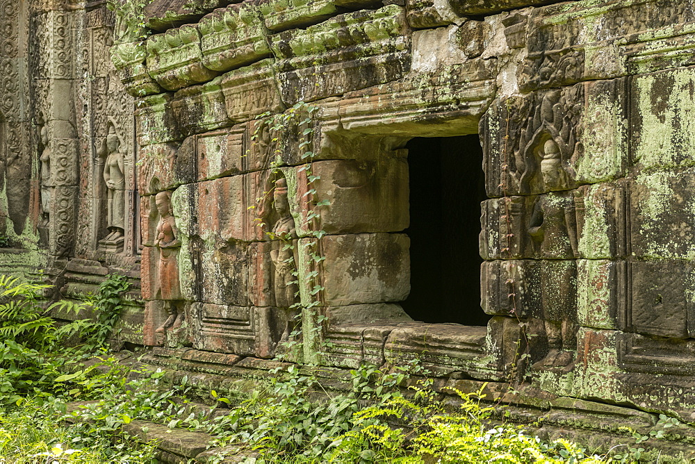 Window in stone wall decorated with bas-reliefs, Preah Khan, Angkor Wat, Siem Reap, Siem Reap Province, Cambodia