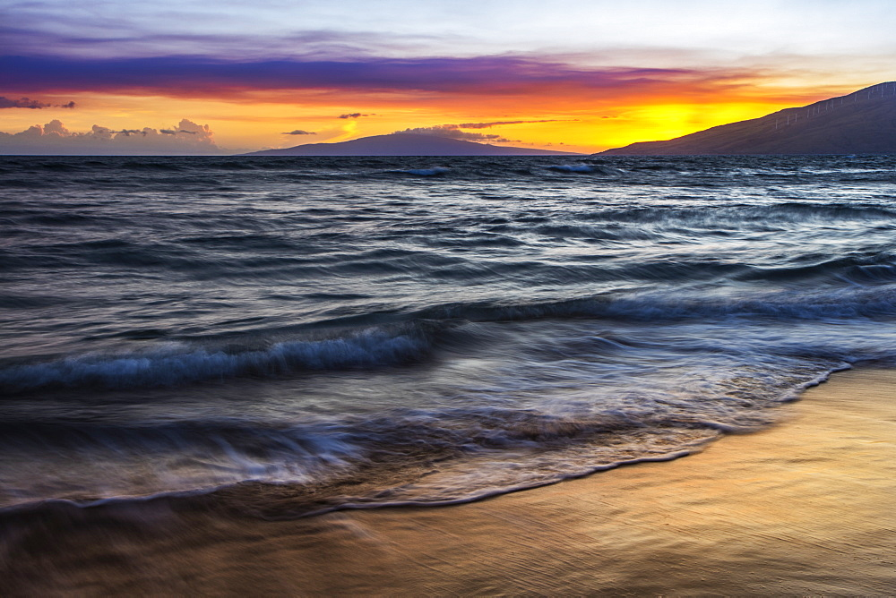 A sunset view with soft water from North Kihei, Maui, Hawaii, United States of America