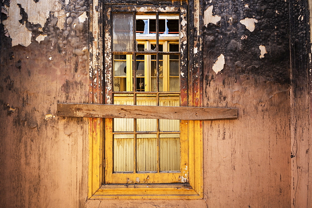 Window in a burned-out building in Barrio Yungay, Santiago, Region Metropolitana, Chile