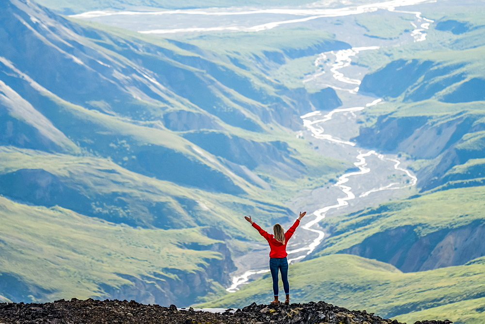 Woman exploring the rugged mountains of Kluane National Park and Reserve, Haines Junction, Yukon, Canada