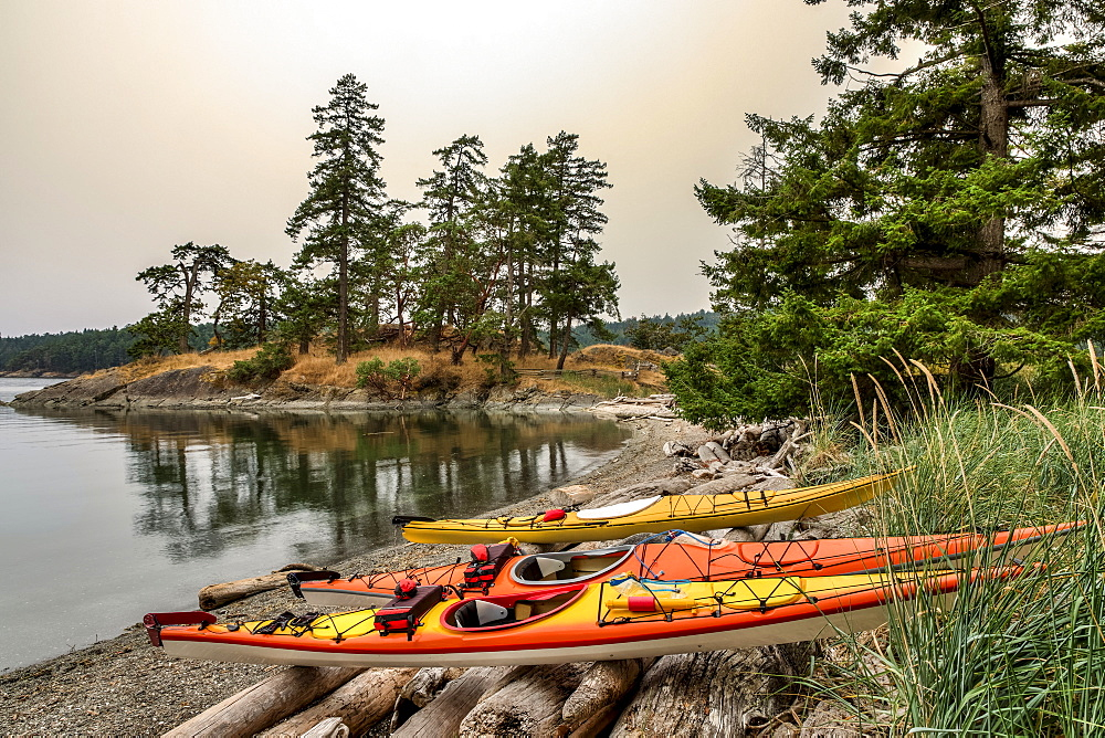 Kayaks on a small Islet at Beaumont Marine Park in Bedwell Harbour, South Pender Island, Pender Island, British Columbia, Canada.