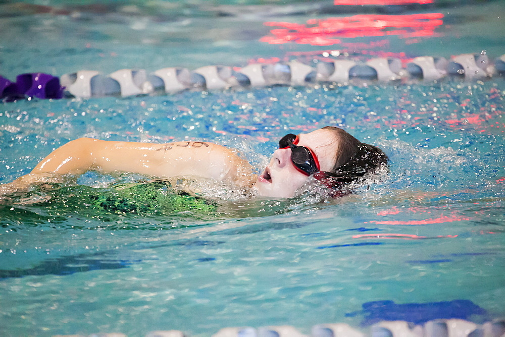 A young woman swimming laps in a lane during a triathalon race, Plano, Texas, United States of America