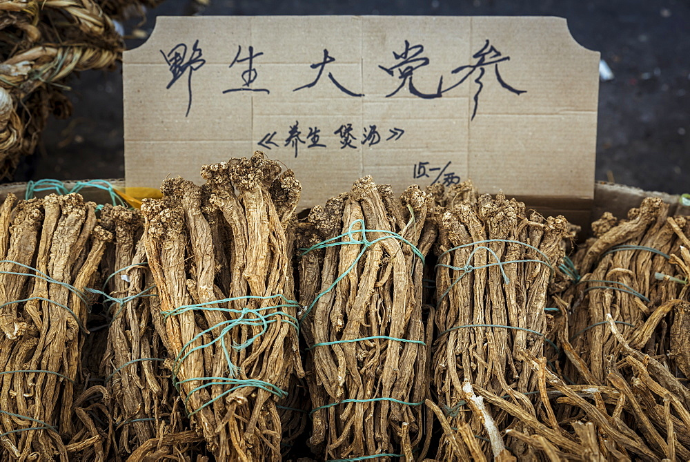 Roots for sale in a street market in Datong, China - 1116-48092