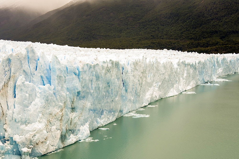 The Perito Moreno Glacier up close showing the blue ice and green water, Cafayate, Santa Cruz Province, Argentina