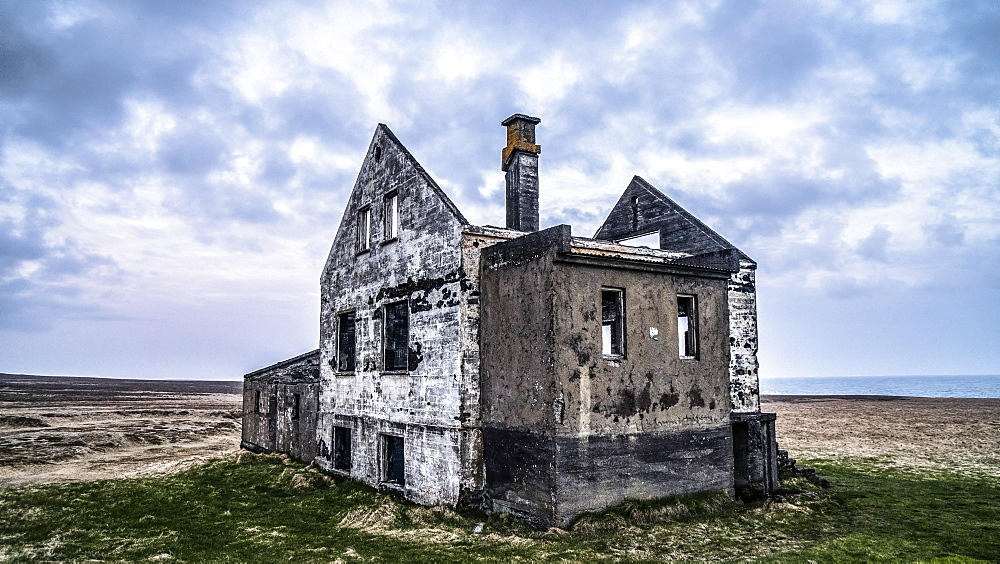 A worn out house in the Snæfellsnes peninsula of Iceland. Several of these houses exist, sometimes with a newer farm close by or in this case, alone, Iceland