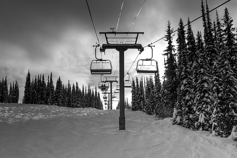 Chair lift at a ski resort in winter, Sun Peaks, British Columbia, Canada