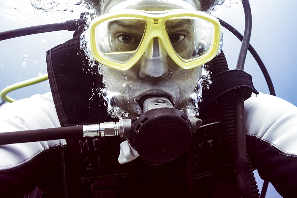 Scuba diver underwater looking at the camera, Belize