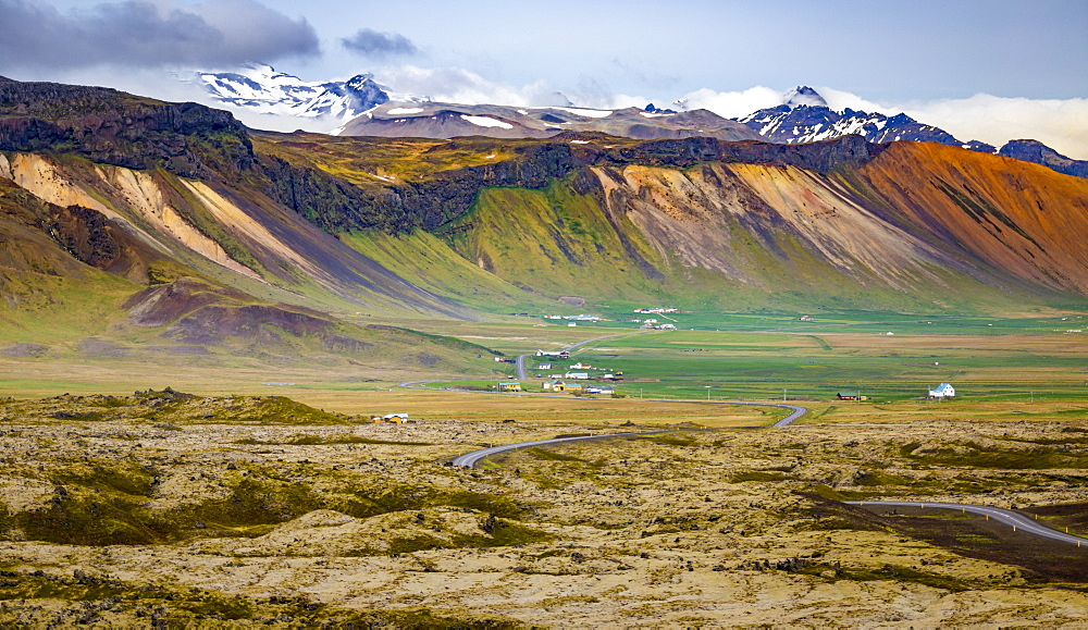 A beautiful long view across the colourful landscape of a valley from a tourist lookout, Iceland