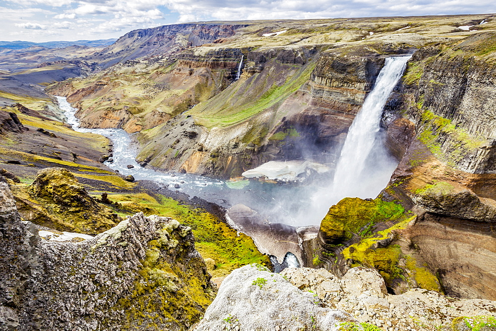 A high viewpoint of one of the waterfalls and rivers in the Haifoss valley with stunning cliffs, natural colors and rock formations, Iceland