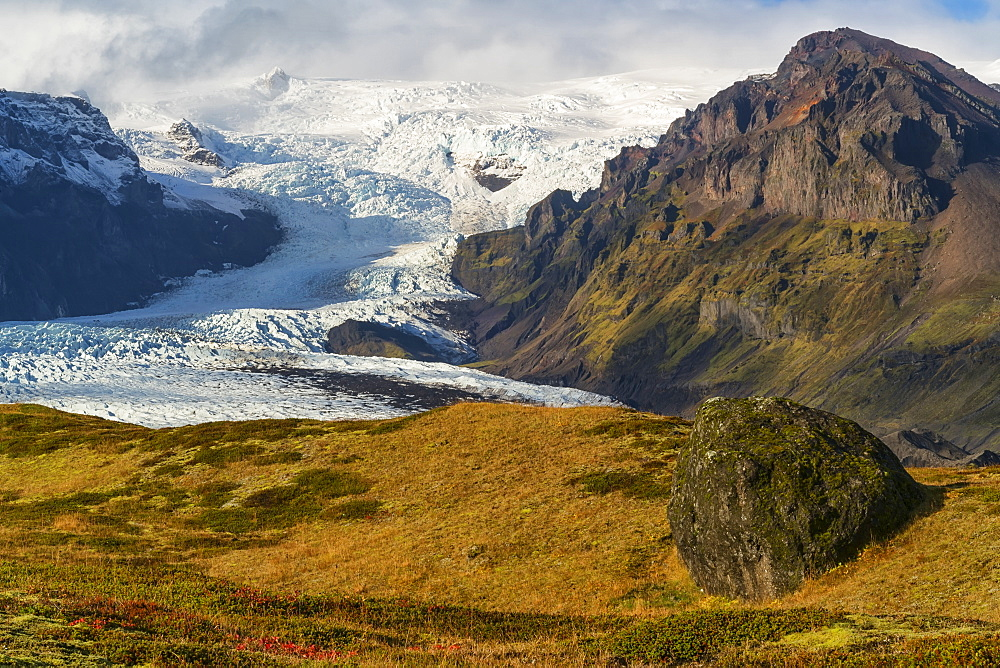 View of a large glacier and the mountains along the South coast of Iceland, part of the Vatnajokull ice cap, Iceland