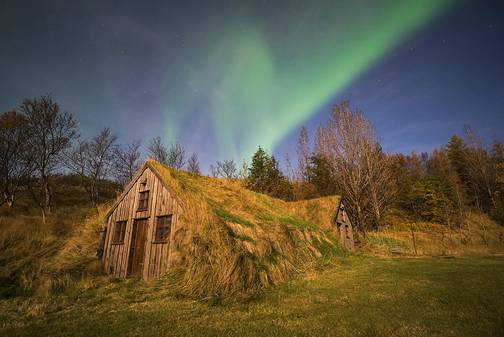 Northern Lights over a sod house along the South coast of Iceland, Iceland