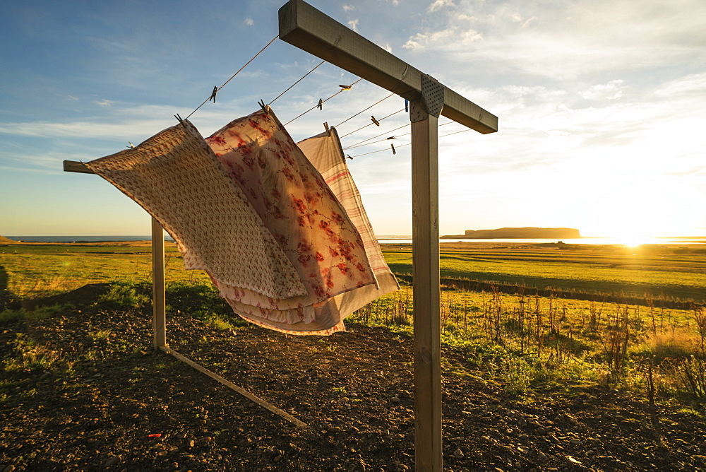 Fabric on a clothesline blowing in the wind at sunset, Vik, Iceland