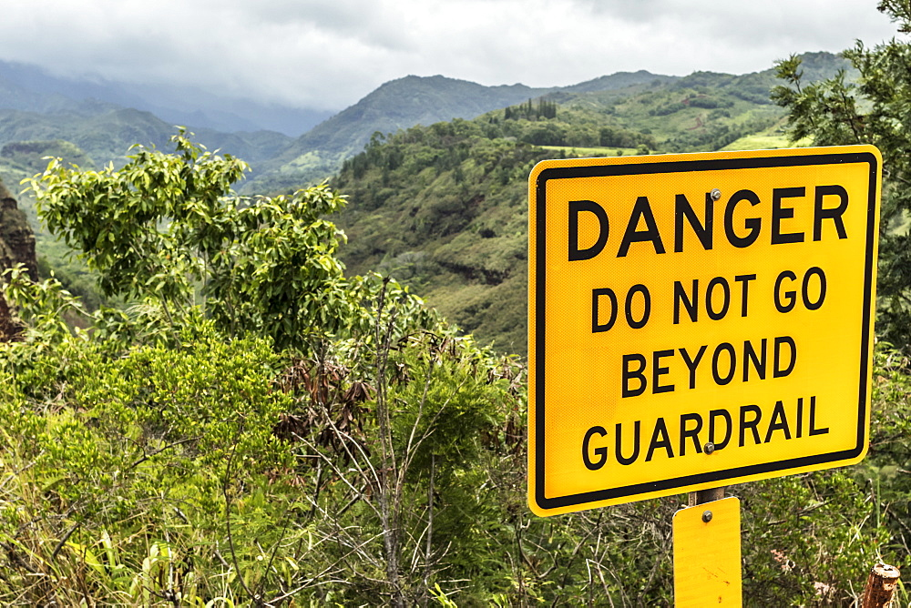 Danger sign at Hanapepe Valley and Canyon Lookout on Kaumualii Highway (Mile 14), also known as Hawaii State Route 50, Kauai, Hawaii, United States of America