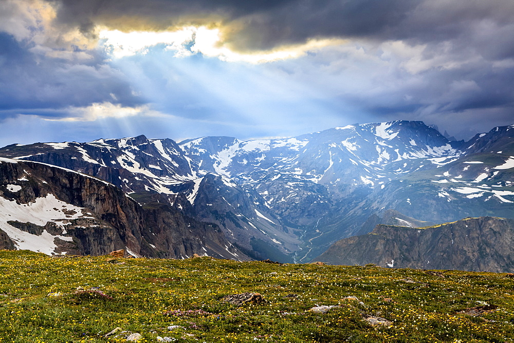 View from the Beartooth Highway of the Beartooth Mountains and the sun rays breaking through the clouds, Cody, Wyoming, United States of America